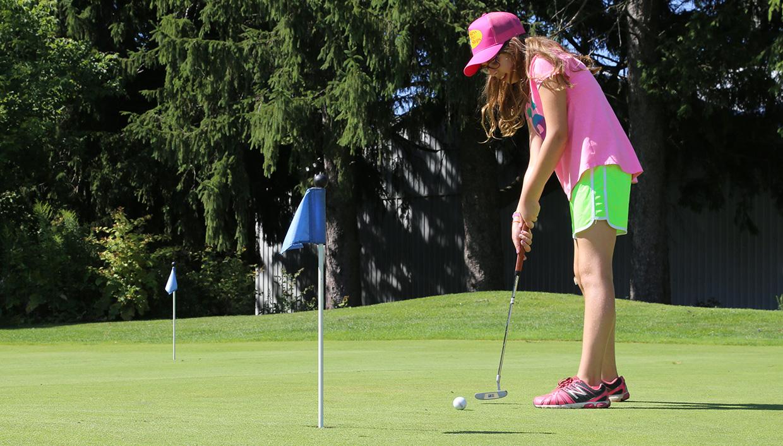 girl practices putting at Bathurst Glen Golf Course